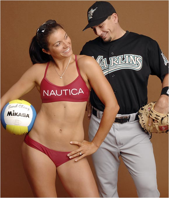 """Florida Marlins catcher Matt Treanor and Olympic volleyball gold medalist Misty May-Treanor have been married for over a year but rarely see each other due to the hectic schedules of their respective sports. """"We do talk to each other two, three times a day on the phone'"""" Misty said recently. """"We both understand the situation is just for the time being."""" The two plan to settle down and start a family after the 2008 Olympics in Beijing."""